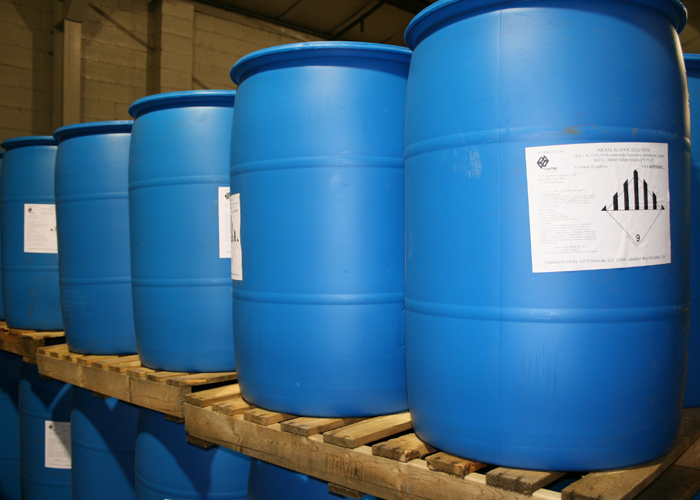 Nickel solution in blue drums sitting on wood pallets