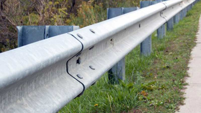 Galvanized guard rails installed on the side of a road